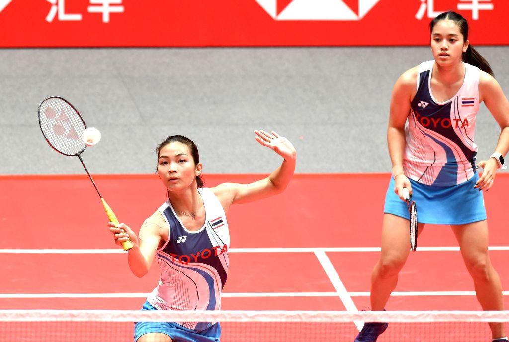 GUANGZHOU, Dec. 11, 2019 - Jongkolphan Kititharakul (L)/Rawinda Prajongjai of Thailand compete during the women's doubles group B match between Matsumoto Mayu/Nagahara Wakana of Japan and Jongkolphan ...