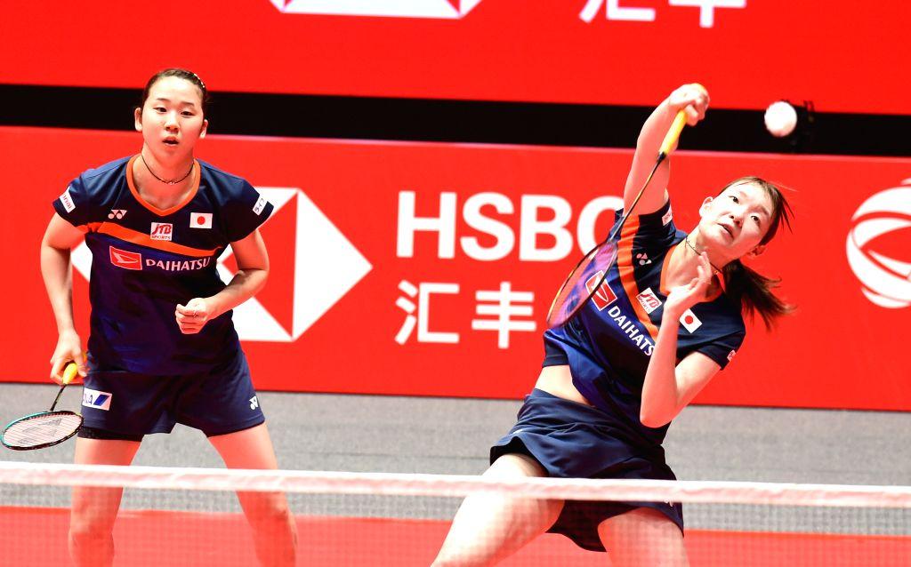 GUANGZHOU, Dec. 11, 2019 - Matsumoto Mayu (R)/Nagahara Wakana of Japan compete during the women's doubles group B match between Matsumoto Mayu/Nagahara Wakana of Japan and Jongkolphan ...