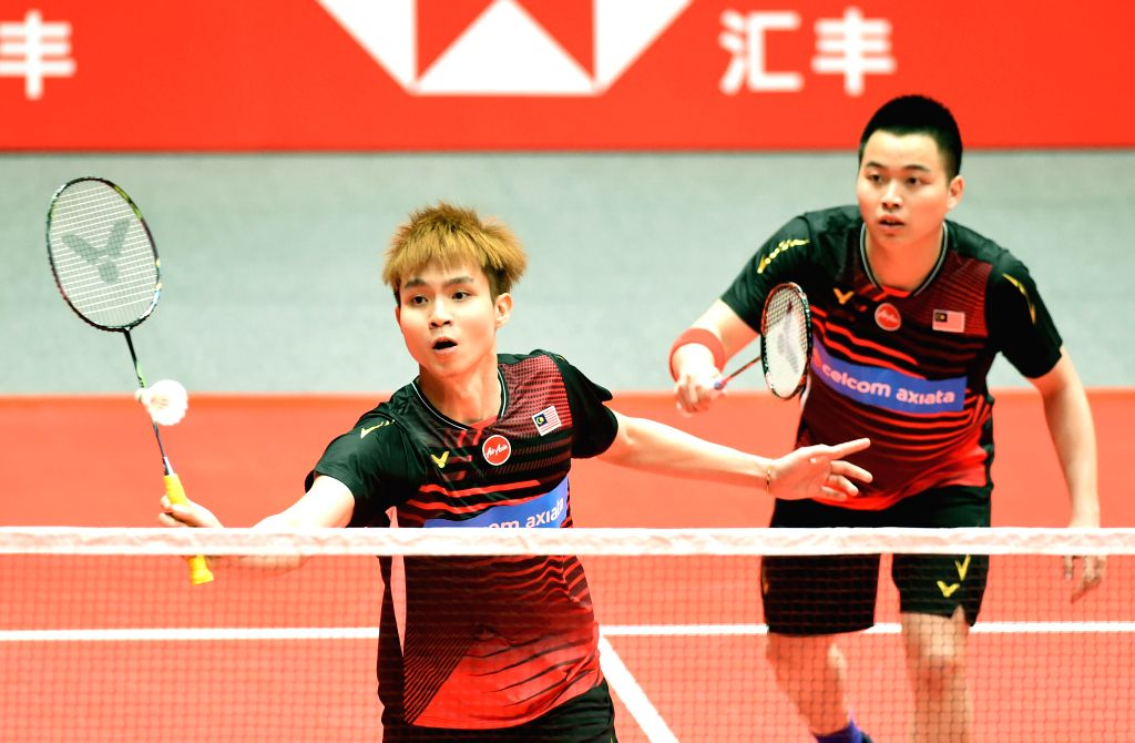 GUANGZHOU, Dec. 12, 2019 - Aaron Chia/Soh Wooi Yik (L) of Malaysia compete during the men's doubles group B match against Lee Yang/Wang Chi-lin of Chinese Taipei at BWF World Tour Finals 2019 in ...