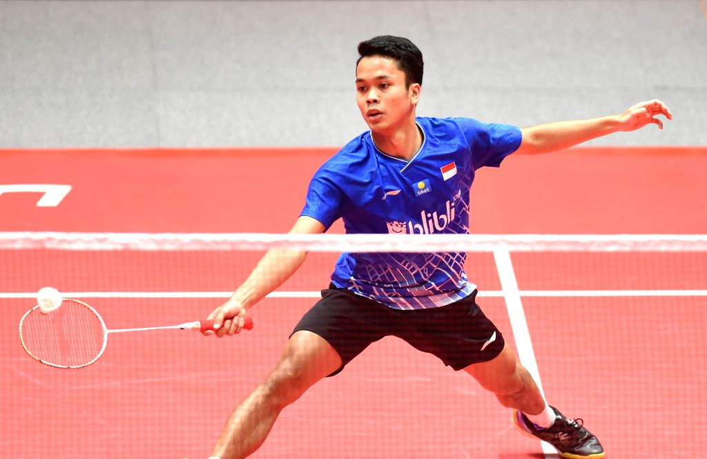 GUANGZHOU, Dec. 12, 2019 - Anthony Sinisuka Ginting of Indonesia hits a return during the men's singles group B match against Chen Long of China at the BWF World Tour Finals 2019 in Guangzhou, ...