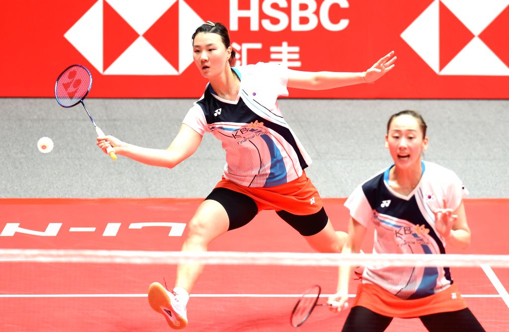 GUANGZHOU, Dec. 12, 2019 - Lee So Hee/Shin Seung Chan (L) of South Korea compete during the women's doubles group B match between Lee So Hee/Shin Seung Chan of South Korea and Mayu Matsumoto/Wakana ...