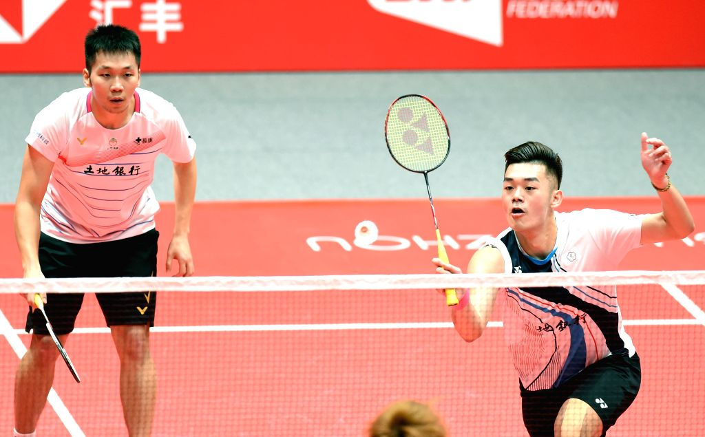 GUANGZHOU, Dec. 12, 2019 - Lee Yang/Wang Chi-lin (R) of Chinese Taipei compete during the men's doubles group B match against Aaron Chia/Soh Wooi Yik of Malaysia at BWF World Tour Finals 2019 in ...