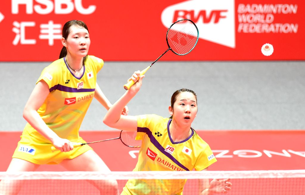 GUANGZHOU, Dec. 12, 2019 - Mayu Matsumoto/Wakana Nagahara (front) of Japan compete during the women's doubles group B match between Lee So Hee/Shin Seung Chan of South Korea and Mayu Matsumoto/Wakana ...
