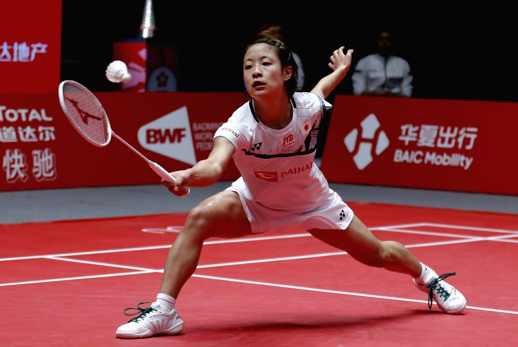 GUANGZHOU, Dec. 12, 2019 - Nozomi Okuhara of Japan hits a return during the women's singles group B match against Busanan Ongbamrungphan of Thailand at the BWF World Tour Finals 2019 in Guangzhou, ...