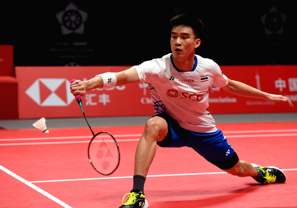 GUANGZHOU, Dec. 13, 2018 - Kantaphon Wangcharoen of Thailand hits a return during the Men's Singles Group B match against Momota Kento of Japan at the BWF World Tour Finals 2018 in Guangzhou, capital ...