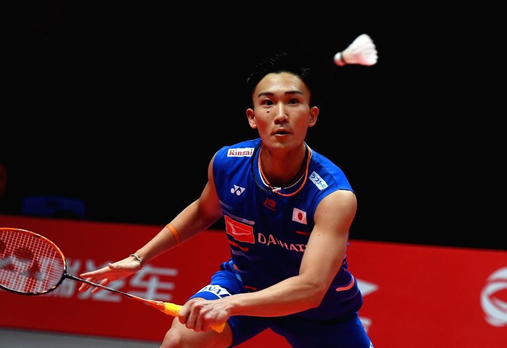 GUANGZHOU, Dec. 13, 2018 - Momota Kento of Japan hits a return during the Men's Singles Group B match against Kantaphon Wangcharoen of Thailand at the BWF World Tour Finals 2018 in Guangzhou, capital ...