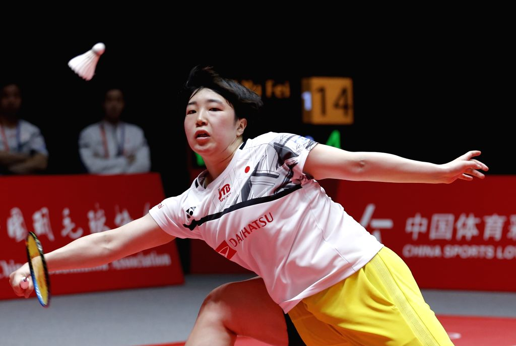 GUANGZHOU, Dec. 13, 2019 - Akane Yamaguchi of Japan returns a shot during the women's singles group A match against Chen Yufei of China at the BWF World Tour Finals 2019 in Guangzhou, capital of ...