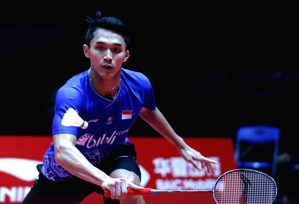 GUANGZHOU, Dec. 13, 2019 - Jonatan Christie of Indonesia returns a shot during the men's singles group A match against Kento Momota of Japan at the BWF World Tour Finals 2019 in Guangzhou, capital of ...
