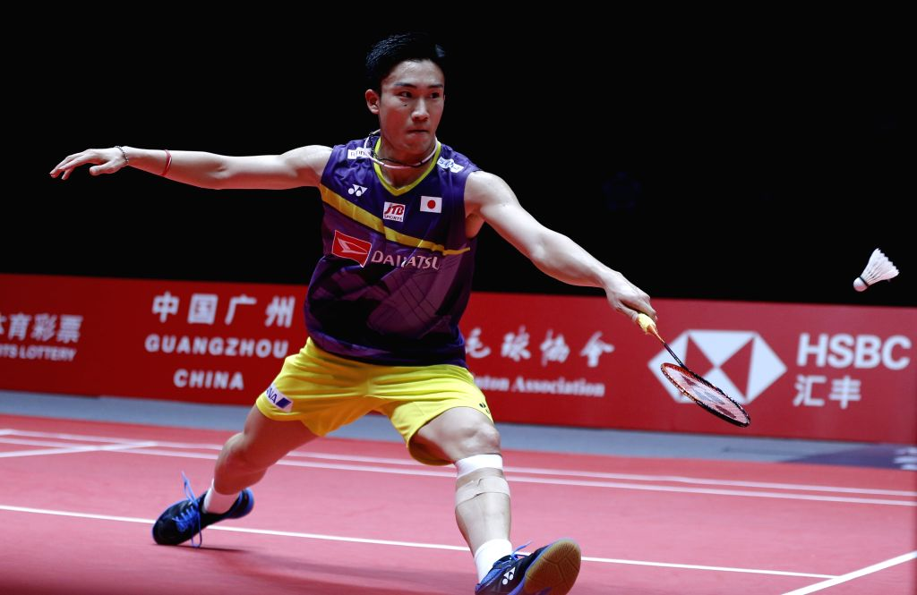 GUANGZHOU, Dec. 13, 2019 - Kento Momota of Japan returns a shot during the men's singles group A match against Jonatan Christie of Indonesia at the BWF World Tour Finals 2019 in Guangzhou, capital of ...
