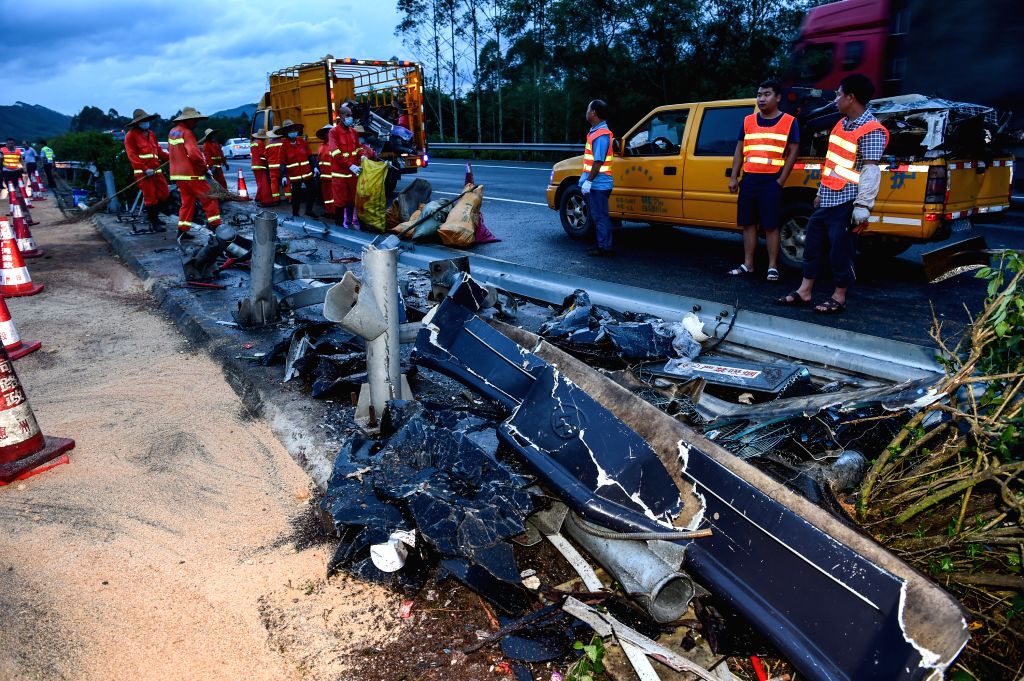 GUANGZHOU, July 6, 2017 - Road administration staff work at the site of a road accident in Longmen, south China's Guangdong Province, July 6, 2017. Nineteen people died, and many others were injured ...
