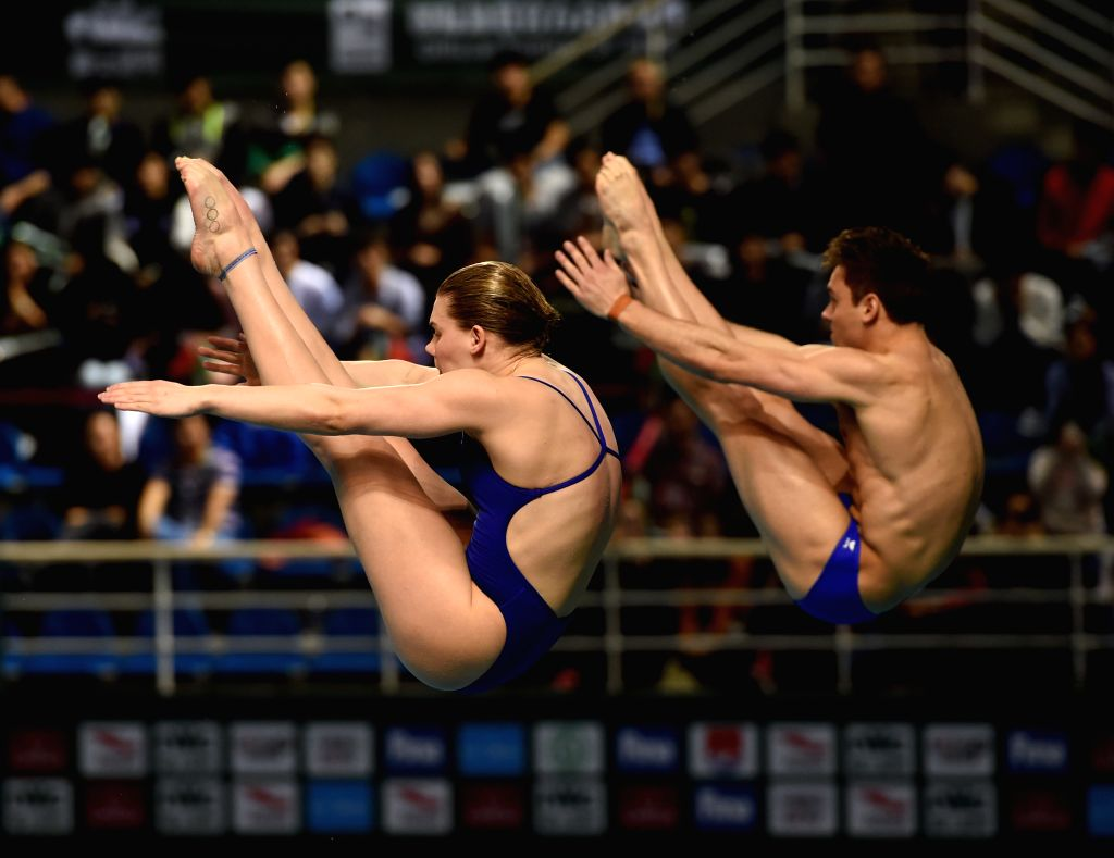 GUANGZHOU, March 10, 2017 - Britain's Grace Reid(L)/Thomas Daley compete during the Mixed 3m Synchronised Springboard event at the 2017 FINA Diving World Series in Guangzhou, capital of south China's ...