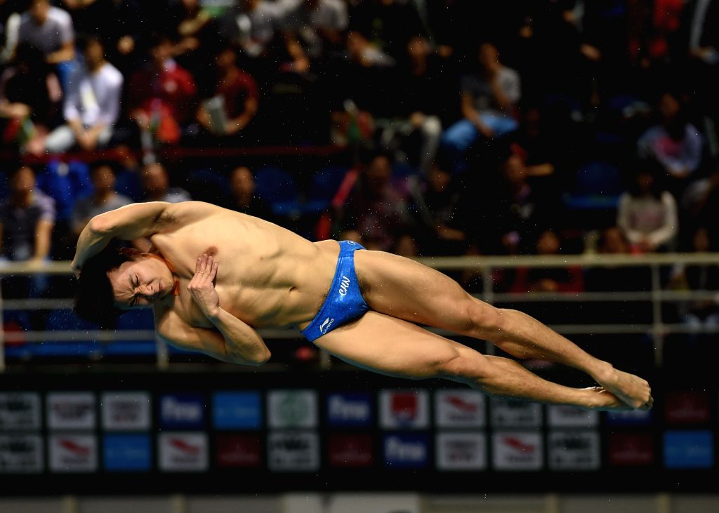 GUANGZHOU, March 10, 2017 - China's Cao Yuan competes during the Men Springboard 3m event at the 2017 FINA Diving World Series in Guangzhou, capital of south China's Guangdong Province, March 10, ...