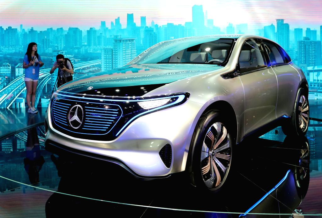 GUANGZHOU, Nov. 18, 2016 - A journalist takes photos at the booth of Mercedez-Benz during the China (Guangzhou) International Automobile Exhibition in Guangzhou, capital of south China's Guangdong ...
