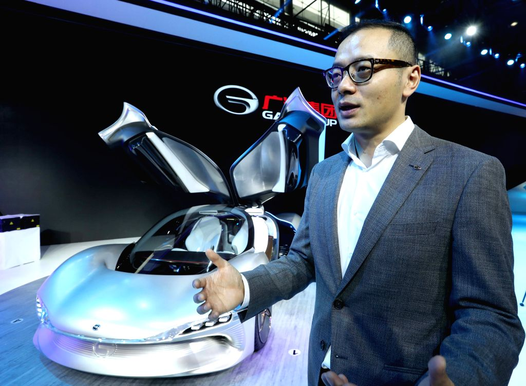 GUANGZHOU, Nov. 18, 2016 - Zhang Fan from the Automotive Engineering Institute of Guangzhou Automobile Group introduces the concept car EnLight during the China (Guangzhou) International Automobile ...