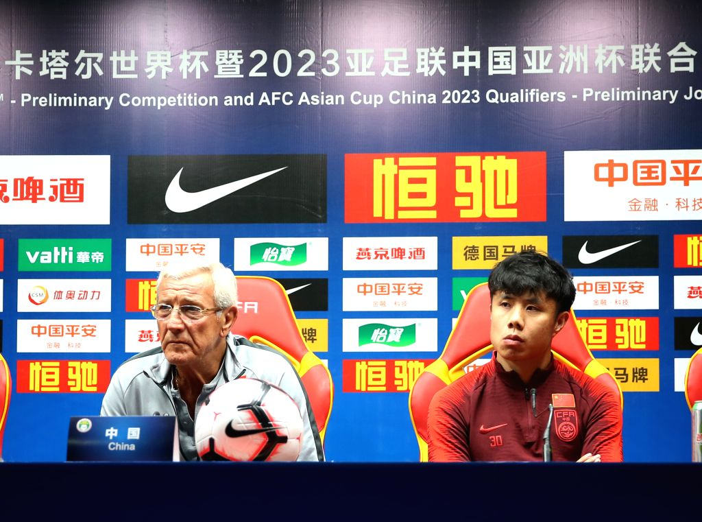 GUANGZHOU, Oct. 9, 2019 - China's head coach Marcello Lippi(L) and China's Hao Junmin attend the press conference one day ahead of the group A second round match between China and Guam at the FIFA ...