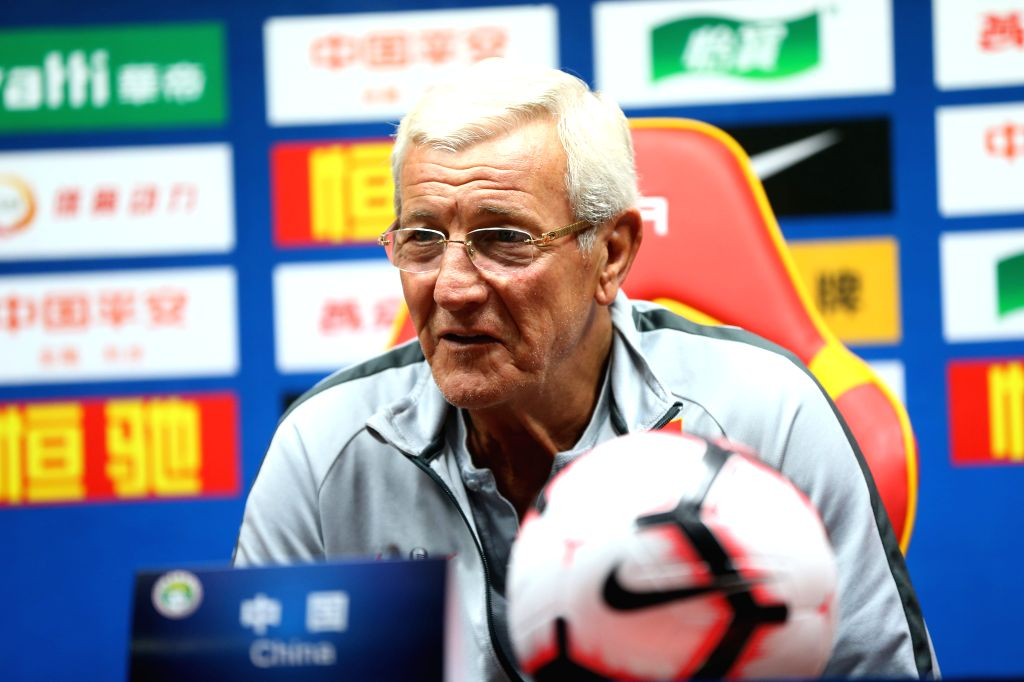 GUANGZHOU, Oct. 9, 2019 - China's head coach Marcello Lippi attends the press conference one day ahead of the group A second round match between China and Guam at the FIFA World Cup Qatar 2022 and ...
