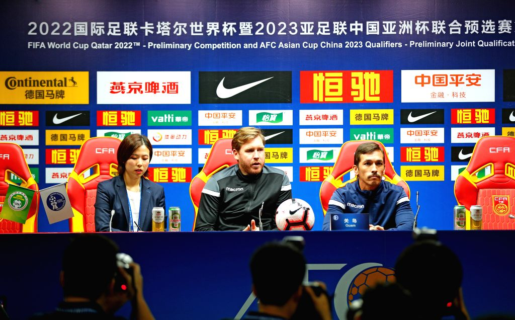 GUANGZHOU, Oct. 9, 2019 - Guam's head coach Karl Dodd of Australia (C) and captain Jason Cunliffe (R) attend the press conference one day ahead of the group A second round match between China and ... - Jason Cunliffe