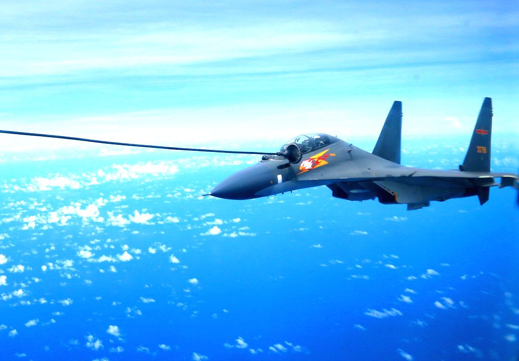 GUANGZHOU, Sept. 13, 2016 - A Chinese Air Force Su-30 fighter is refueled during a routine combat simulation drill over the West Pacific Sept. 12, 2016. The Chinese Air Force on Monday sent multiple ...