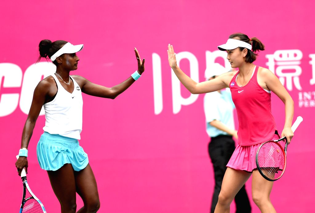 GUANGZHOU, Sept. 23, 2016 - Peng Shuai (R) of China and Asia Muhammad of the United States clap hands during their doubles semifinal match against Liu Chang and Lu Jiajing of China at 2016 WTA ...