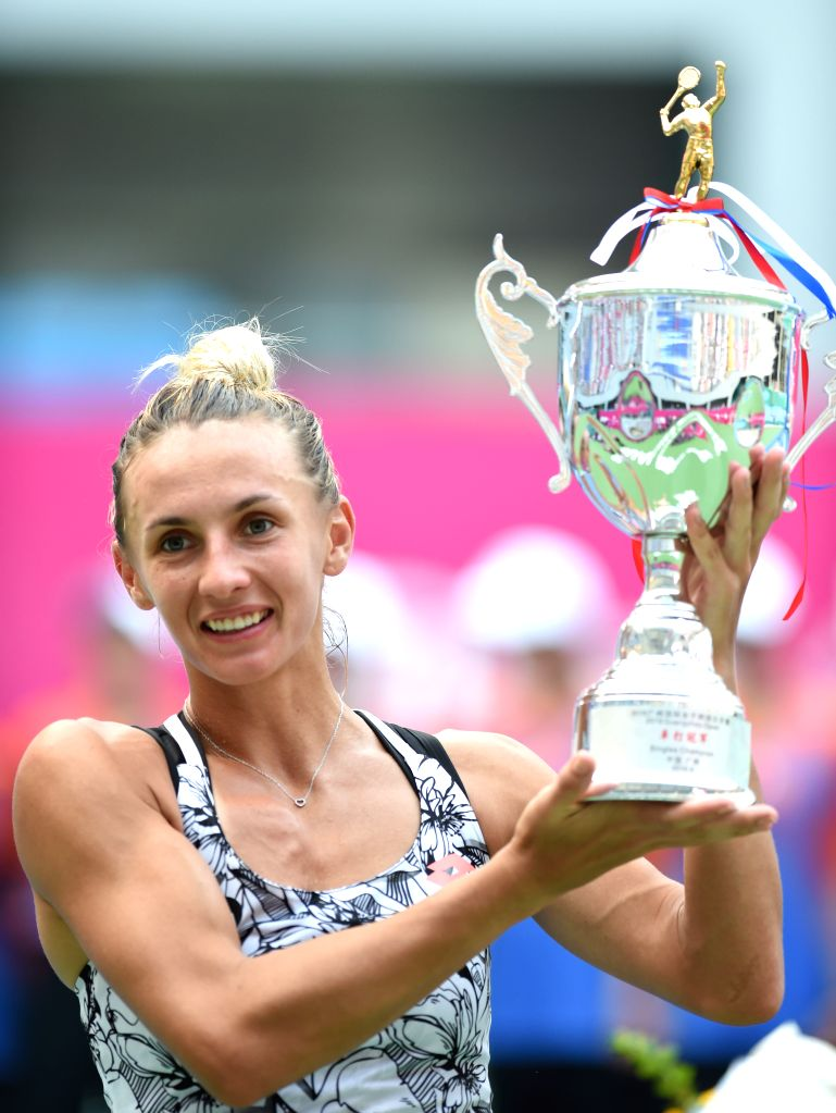 GUANGZHOU, Sept. 24, 2016 - Lesia Tsurenko of Ukraine poses with her trophy after the singles final against Jelena Jankovic of Serbia at 2016 WTA Guangzhou International Women's Open tennis ...