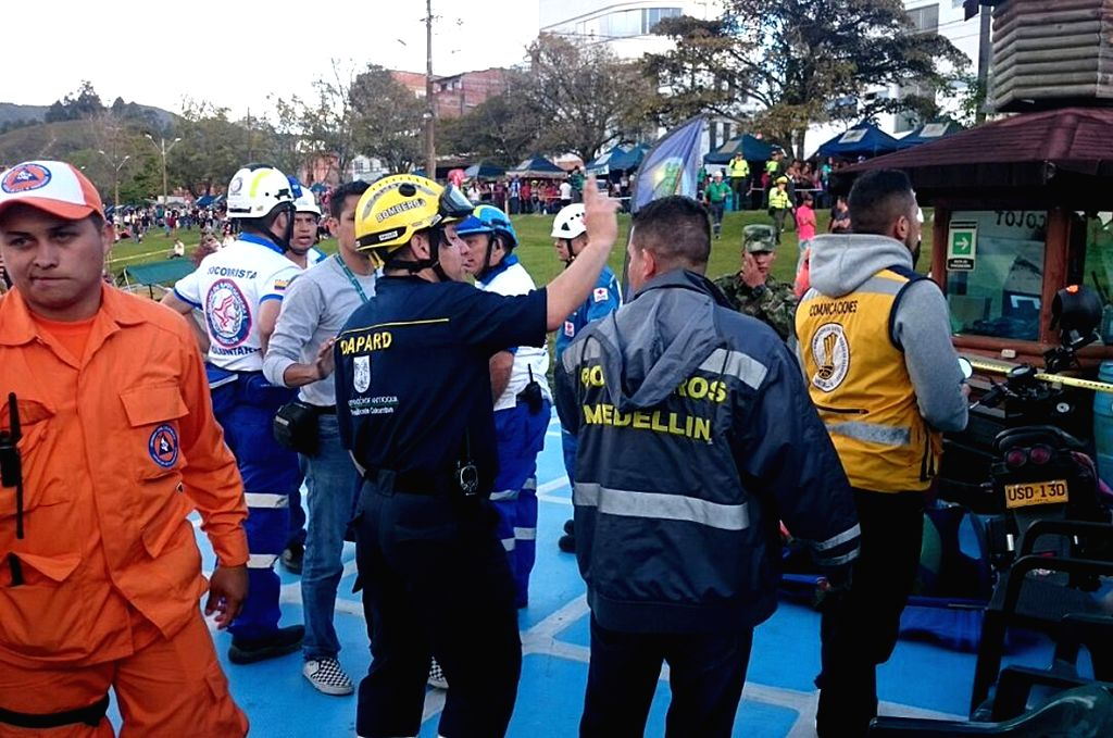 GUATAPE(COLOMBIA), June 26, 2017 Image provided by Administrative Depratment of Disaster Prevention (DAPARD) shows rescuers and police officers reacting before boarding a boat towards the ...