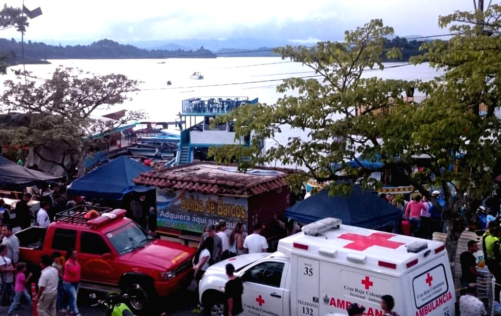 GUATAPE(COLOMBIA), June 26, 2017 Image provided by Administrative Department of Disaster Prevention (DAPARD) shows ambulance and rescue vehicles arriving to a dock where tour boats berth, ...