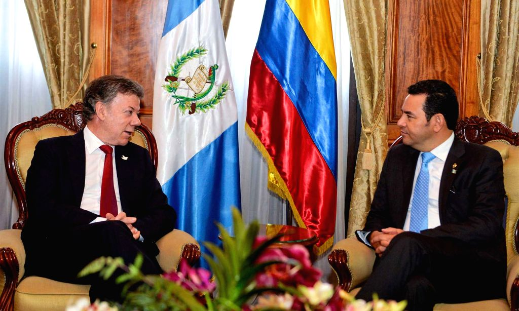 GUATEMALA CITY, April 5, 2016 - Guatemala's President Jimmy Morales (R) meets with his Colombian counterpart Juan Manuel Santos in Guatemala City, capital of Guatemala, on April 4, 2016.