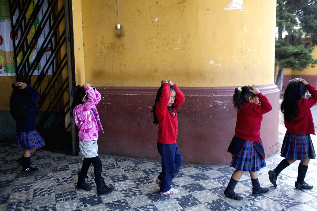 Students of Jose Joaquin Palma School take part in an earthquake drill in Guatemala City, capital of Guatemala, on Aug. 7, 2014. The earthquake drill was held