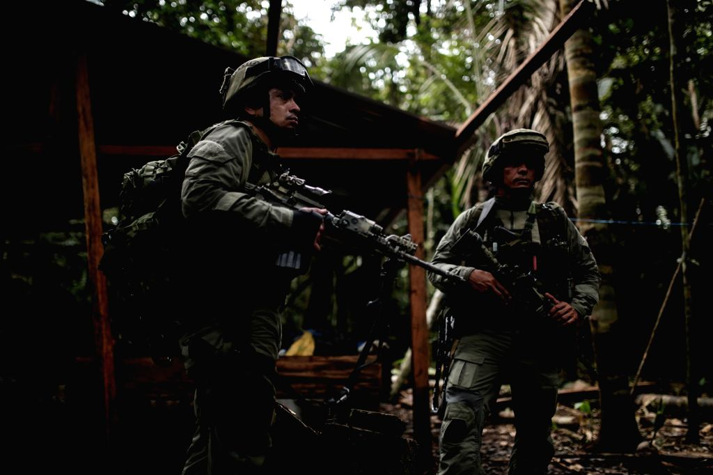 GUAVIARE (COLOMBIA), Aug. 3, 2016 Member of the jungle group of the Counter-narcotics Police stand on guard in a rural zone of Calamar Municipality, Guaviare Department, Colombia, on Aug. ...