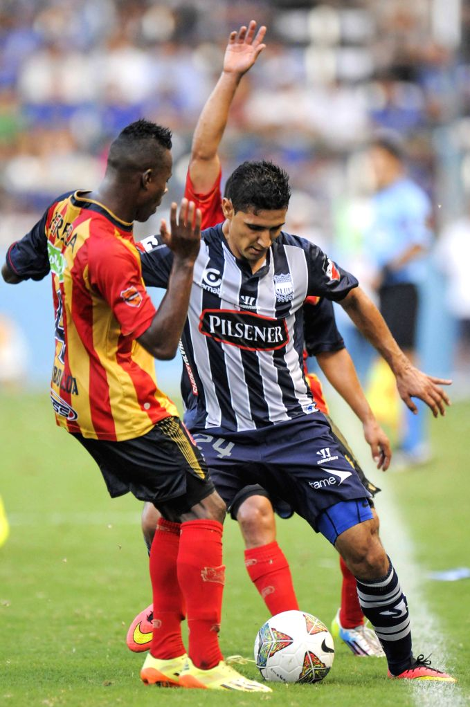 Fernando Gimenez (R) of Emelec, of Ecuador vies for the ball with Carlos Arboleda of Aguilas Doradas, of Colombia, during the match of the South American Cup, ...
