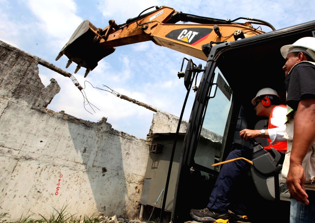 GUAYAQUIL, Dec., 20, 2013 (Xinhua/IANS)Ecuador's President Rafael Correa (2nd R) takes part in the demolition of a wall of the Litoral Prison, in Guayaquil, Ecuador, on Dec. 19, 2013. ...