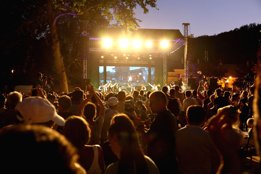 GUCA, Aug. 11, 2019 - Audience applaud in a performance of a brass band during the 59th Guca Trumpet Festival in the town of Guca, Serbia, Aug. 10, 2019. The 59th Guca Trumpet Festival that takes ...