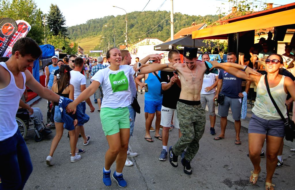 """GUCA, Aug. 11, 2019 - People take part in """"kolo"""", Serbian traditional dance, during the 59th Guca Trumpet Festival in the town of Guca, Serbia, Aug. 10, 2019. The 59th Guca Trumpet Festival ..."""