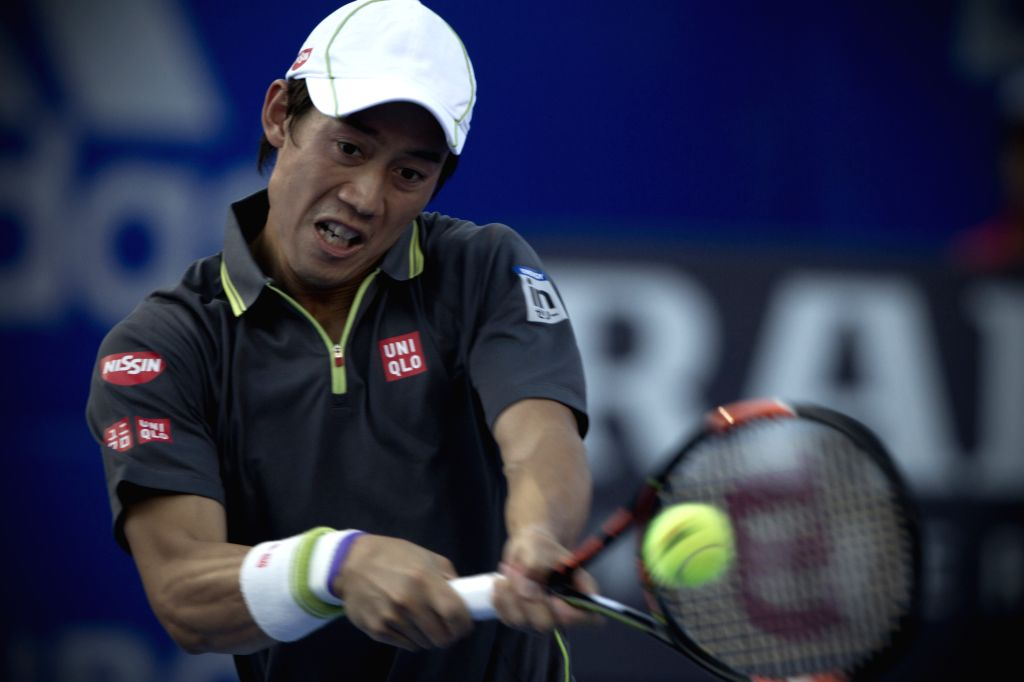 Japan's Kei Nishikori hits a return to South Africa's Kevin Anderson during the men's single semifinal match of the Mexican Tennis Open 2015 torunament in ...