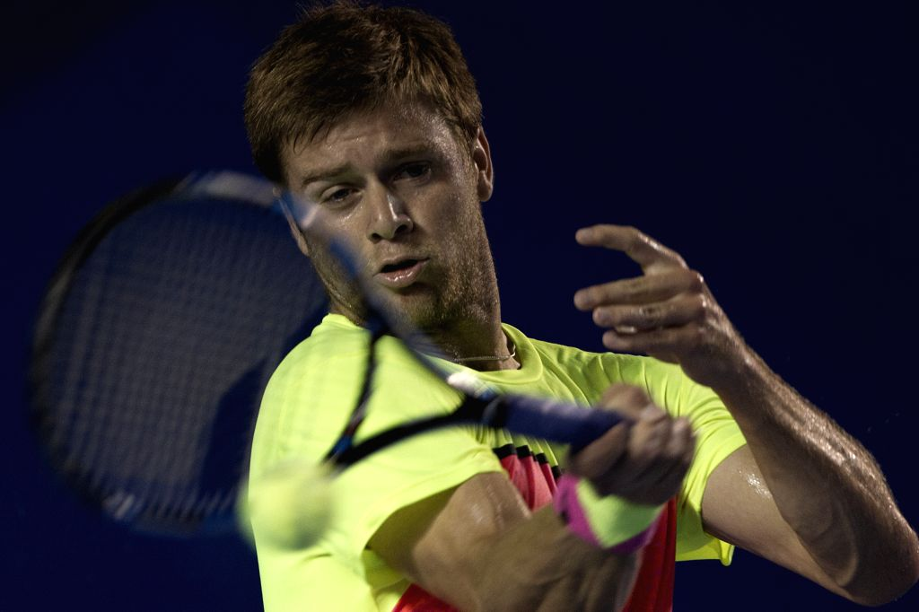 Ryan Harrison of the U.S. hits a return to David Ferrer of Spain during the men's single semifinal of the Mexican Tennis Open 2015 torunament in Acapulco, of ...