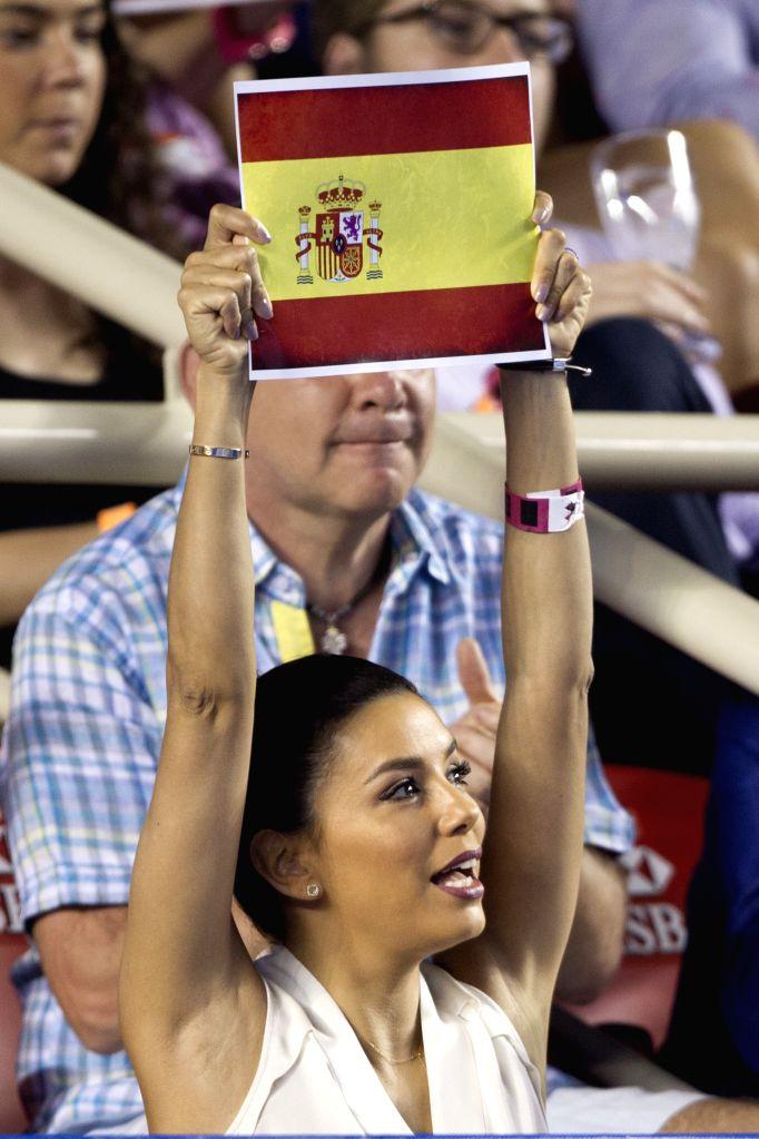 Actress Eva Longoria holds a Spanish flag during the final match of men's singles of the Mexican Tennis Open 2015 tournament between Japan's Kei Nishikori and ... - Eva Longoria