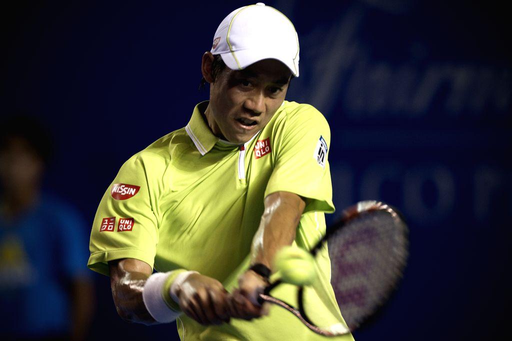 Japan's Kei Nishikori, returns the ball during the men's singles final match against Spain's David Ferrer on the Mexican Tennis Open 2015 tournamentin Acapulco, ...