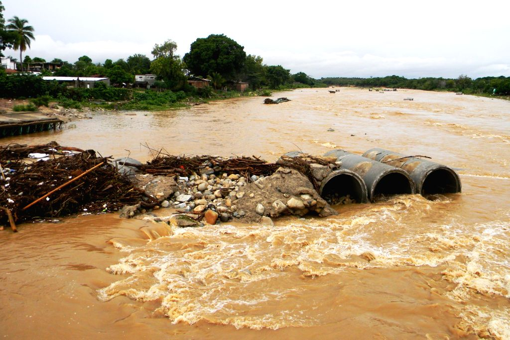 The river is flooding in El Ticui community of the municipality of Atoyac de Alvarez, Guerrero, Mexico, on Sept. 1, 2014. The strong rainfalls registered in the ...