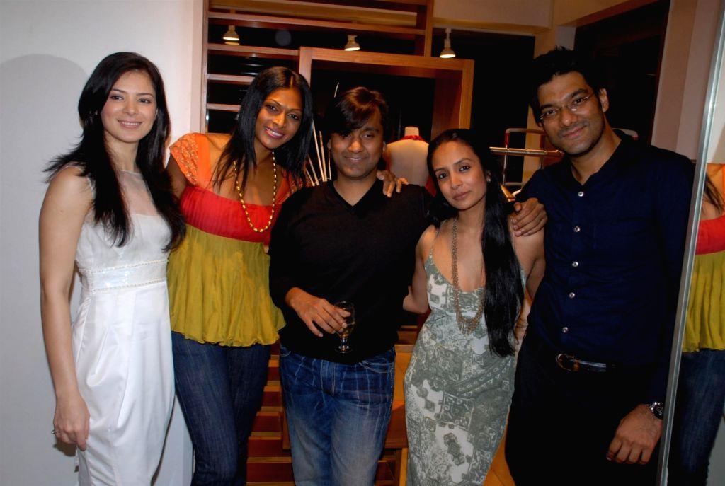 Guests at the fashion preview of designer Raakesh Agarwal in Mumbai Friday.