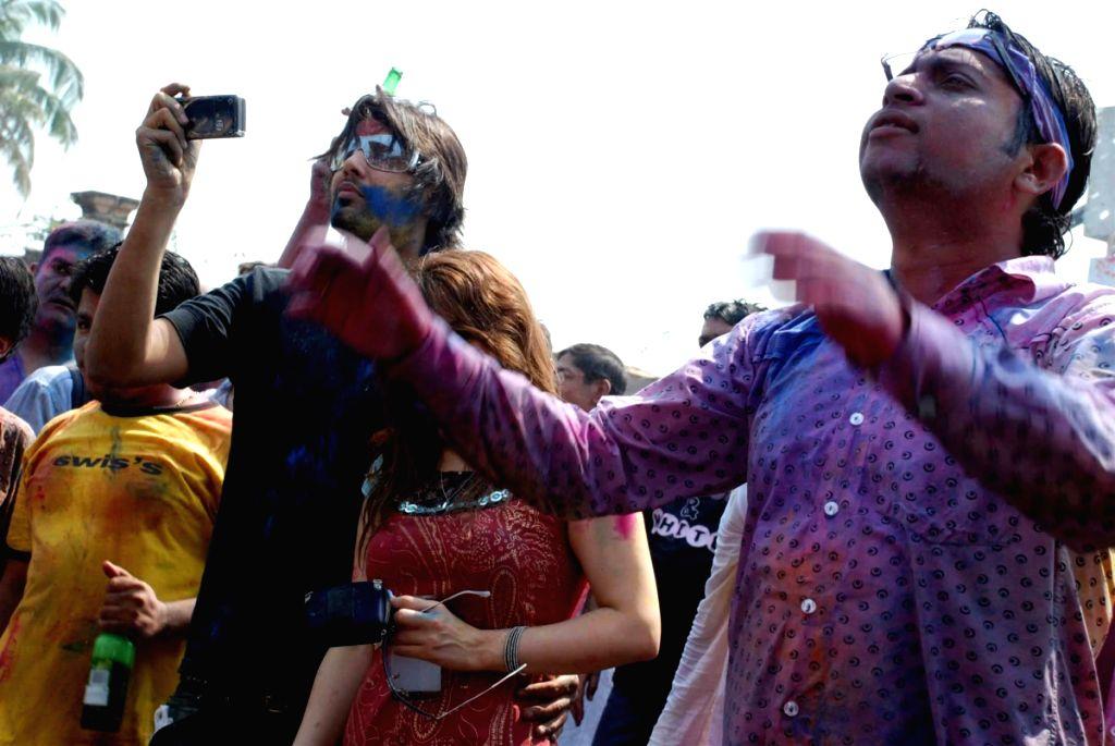 Guests at Zoom Holi bash.