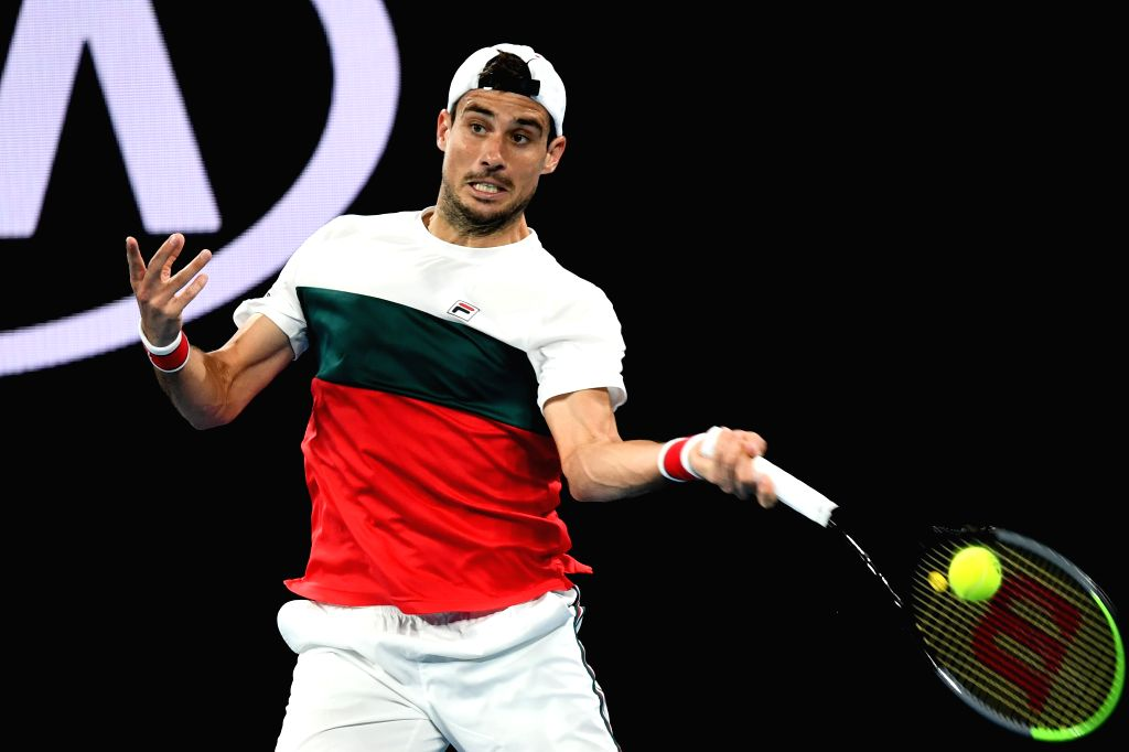 Guido Pella of Argentina hits the ball during the men's singles third round match against Fabio Fognini of Italy at the 2020 Australian Open tennis tournament in ...
