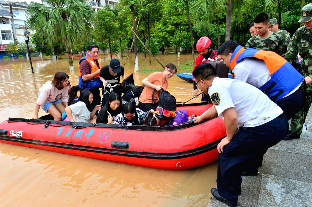 GUILIN, July 3, 2017 - Rescuers transfer trapped students of Guilin Tourism University in Guilin, south China's Guangxi Zhuang Autonomous Region, July 3, 2017. As of 2:00 p.m. Monday, more than 4,000 ...