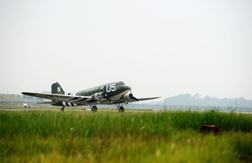 GUILIN, Nov. 19, 2016 - A C-47 aircraft, contributed by the Flying Tiger Historical Organization in the United States, lands at the Liangjiang airport in Guilin, south China's Guangxi Zhuang ...
