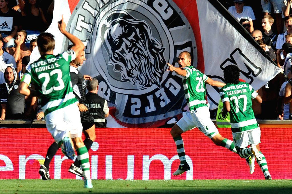 GUIMARAES, Aug. 20, 2017 - Sporting's Dost (2nd R) celebrates after scoring during the Portuguese League soccer match between Vitoria SC and Sporting CP in Guimaraes, Portugal, on Aug. 19, 2017. ...