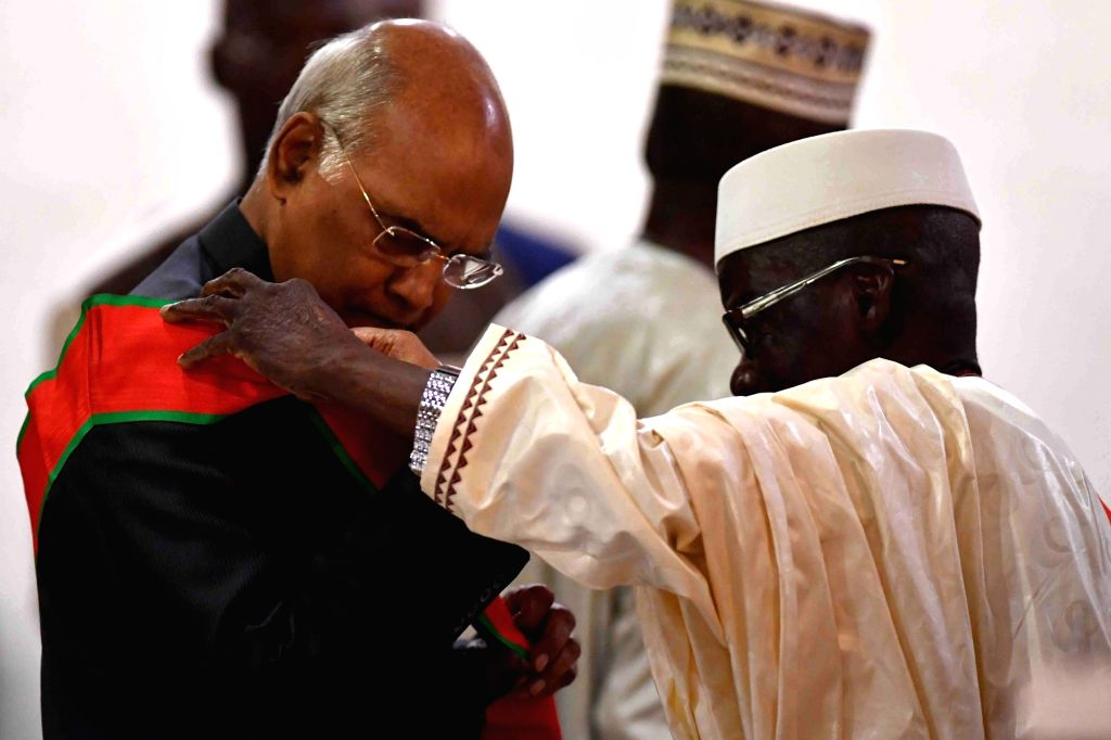 Guinea President Alpha Conde confers the National Order of Merit of Guinea, the highest award of the West African nations, on President Ram Nath Kovind during a banquet hosted in his honour ... - Nath Kovind