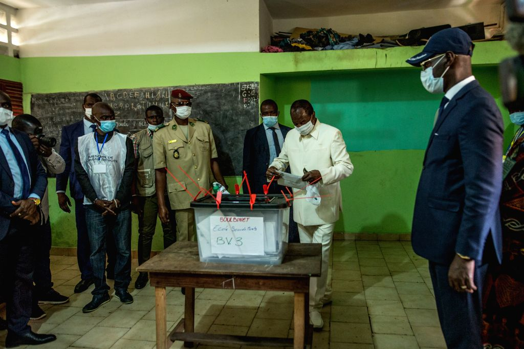 Guinean President Alpha Conde casts his ballot at a polling station in Conakry, Guinea, Oct. 18, 2020. Guinean citizens began to vote in the presidential election ...