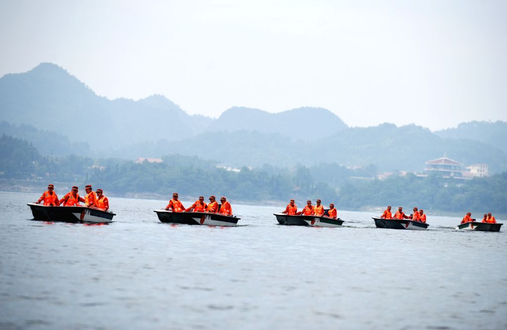 GUIYANG, June 2, 2019 - A batch of armed police participate in a flood control and relief drill on the Hongfeng Lake in Qingzhen City, southwest China's Guizhou Province, June 2, 2019.