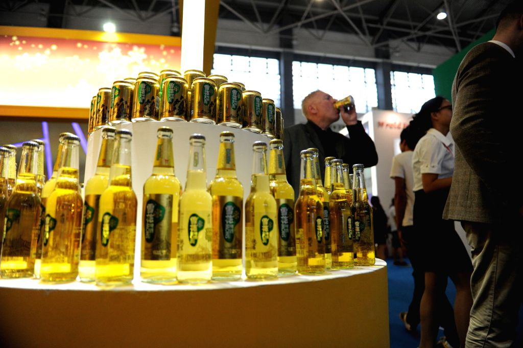 Bottles of beer are exhibited at the 4th China Guizhou International Alcoholic Beverages Expo in Guiyang, capital of southwest China's Guizhou Province, Sept. 9, ...