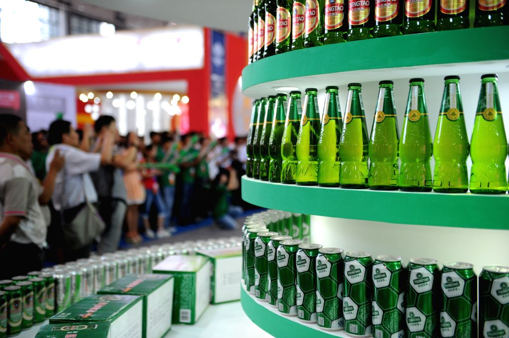 People visit the 4th China Guizhou International Alcoholic Beverages Expo in Guiyang, capital of southwest China's Guizhou Province, Sept. 9, 2014. The expo kicked .