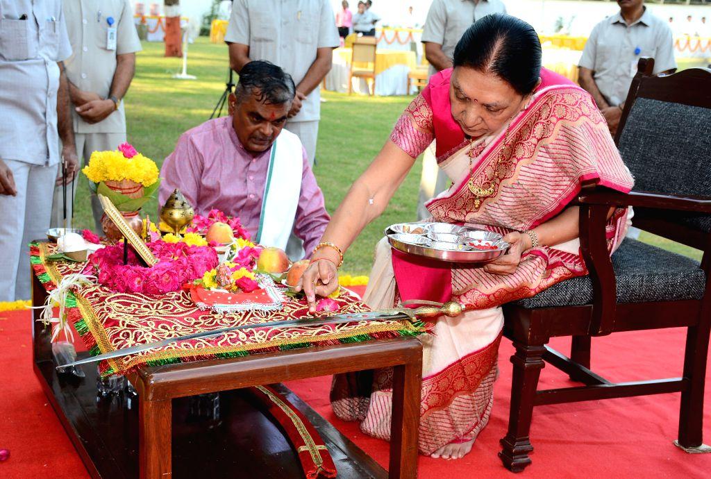 Gujarat Chief Minister Anandiben Patel performs 'Shastra Puja' on Vijaya Dashmi in Gandhinagar, on Oct 22, 2015. - Anandiben Patel